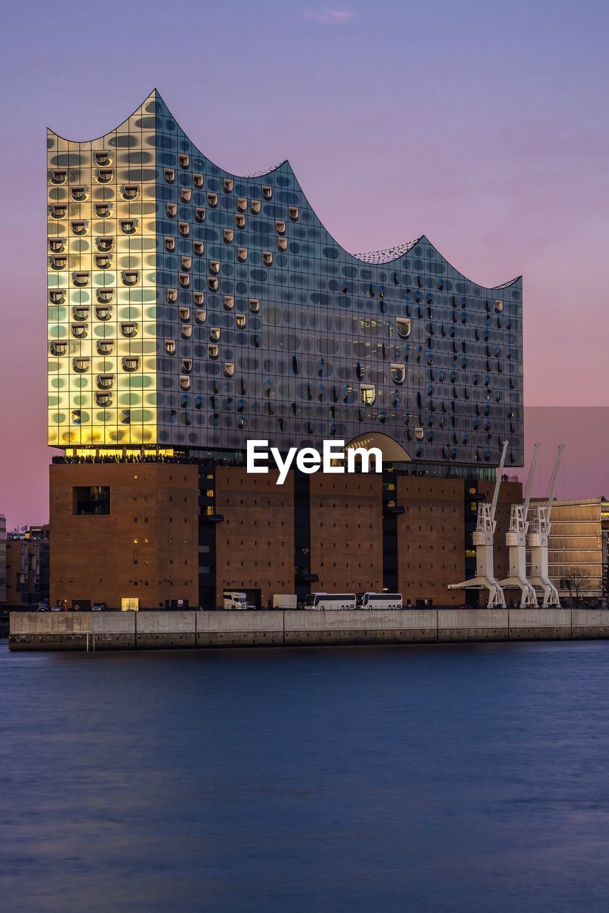 architecture, building exterior, built structure, sky, water, building, waterfront, city, travel destinations, nature, no people, outdoors, modern, sunset, travel, dusk, office building exterior, sea, day, skyscraper