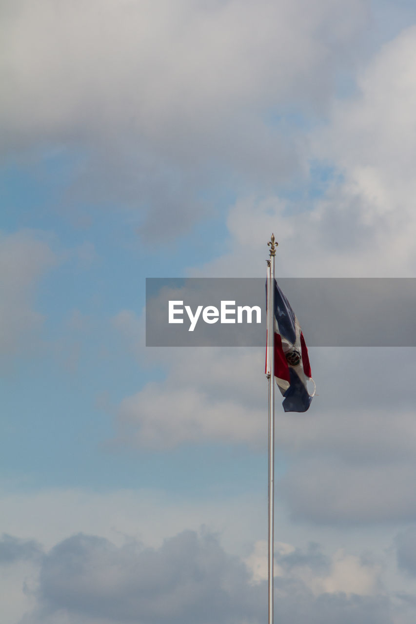 flag, patriotism, cloud - sky, pride, national icon, sky, low angle view, flag pole, wind, no people, blue, day, outdoors, nature, stars and stripes