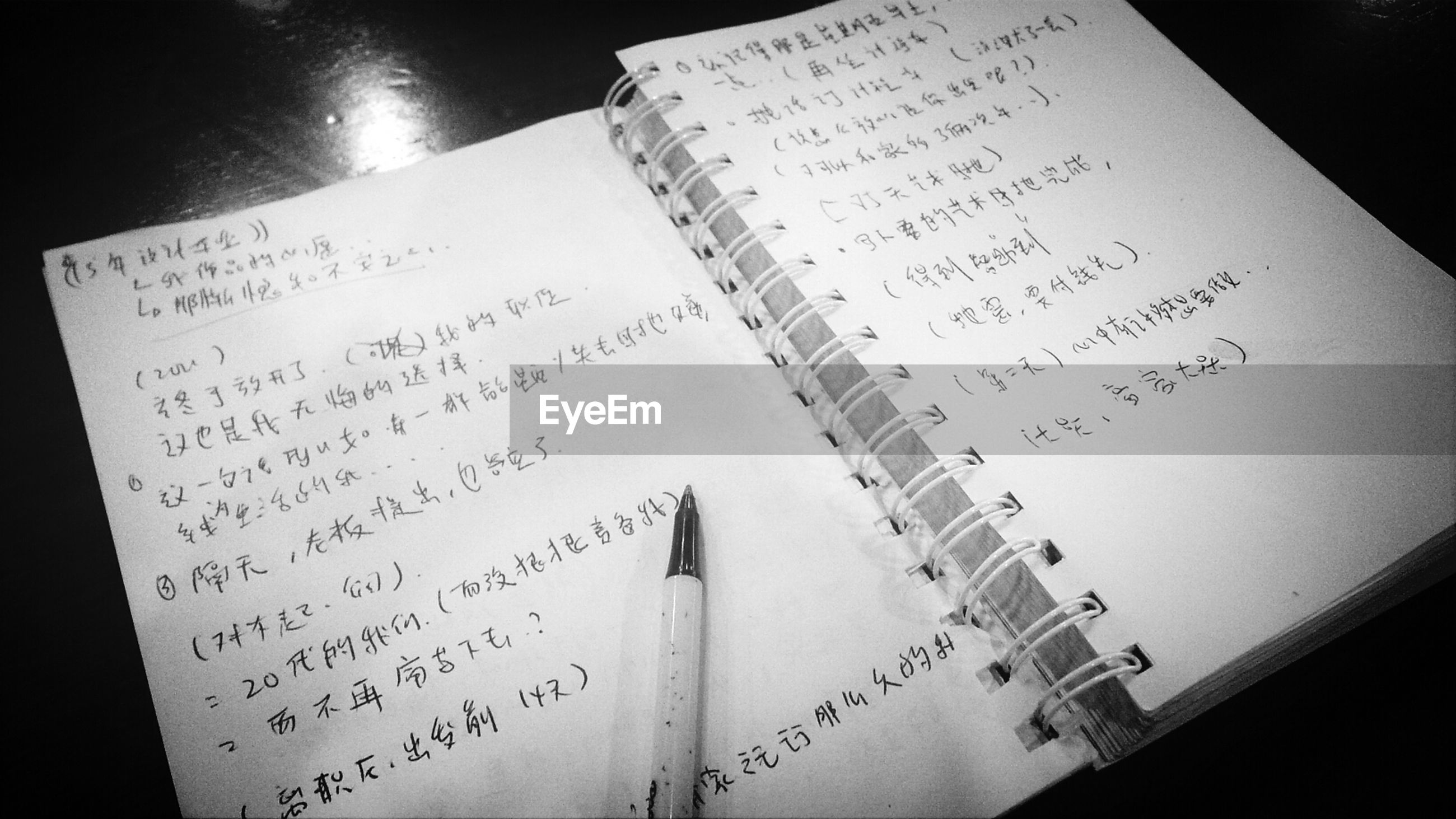 text, indoors, western script, communication, paper, book, education, close-up, page, still life, table, no people, high angle view, handwriting, open, document, pen, wood - material, information, non-western script