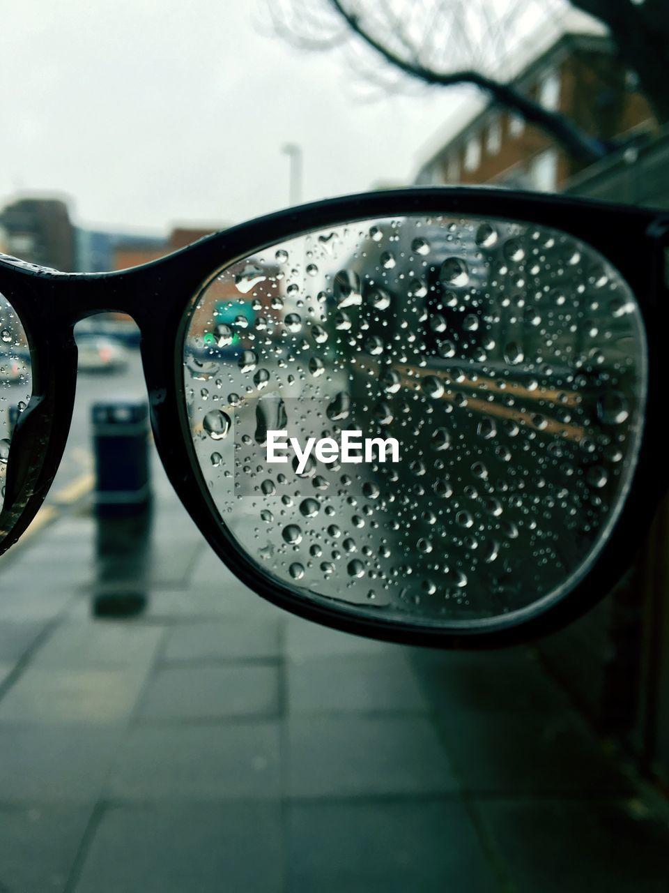 Close-up of raindrops on eyeglasses