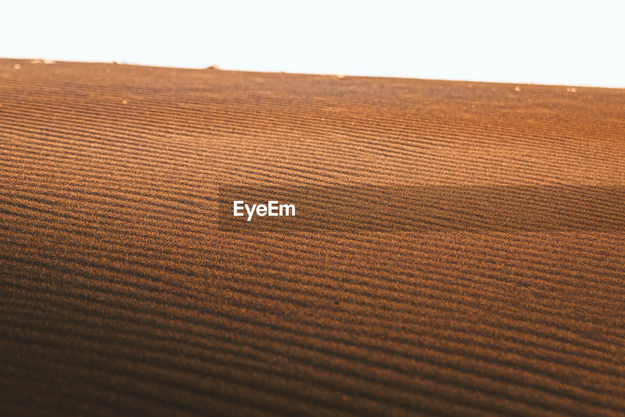 pattern, brown, textured, no people, close-up, sky, selective focus, landscape, land, textile, sand, indoors, backgrounds, nature, sand dune, full frame, natural pattern, tranquility, day, arid climate
