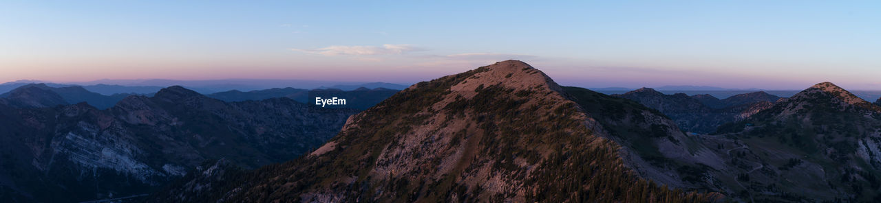 sky, mountain, beauty in nature, mountain range, scenics - nature, tranquil scene, tranquility, non-urban scene, idyllic, sunset, nature, mountain peak, rock, cloud - sky, no people, environment, landscape, remote, panoramic, outdoors, formation