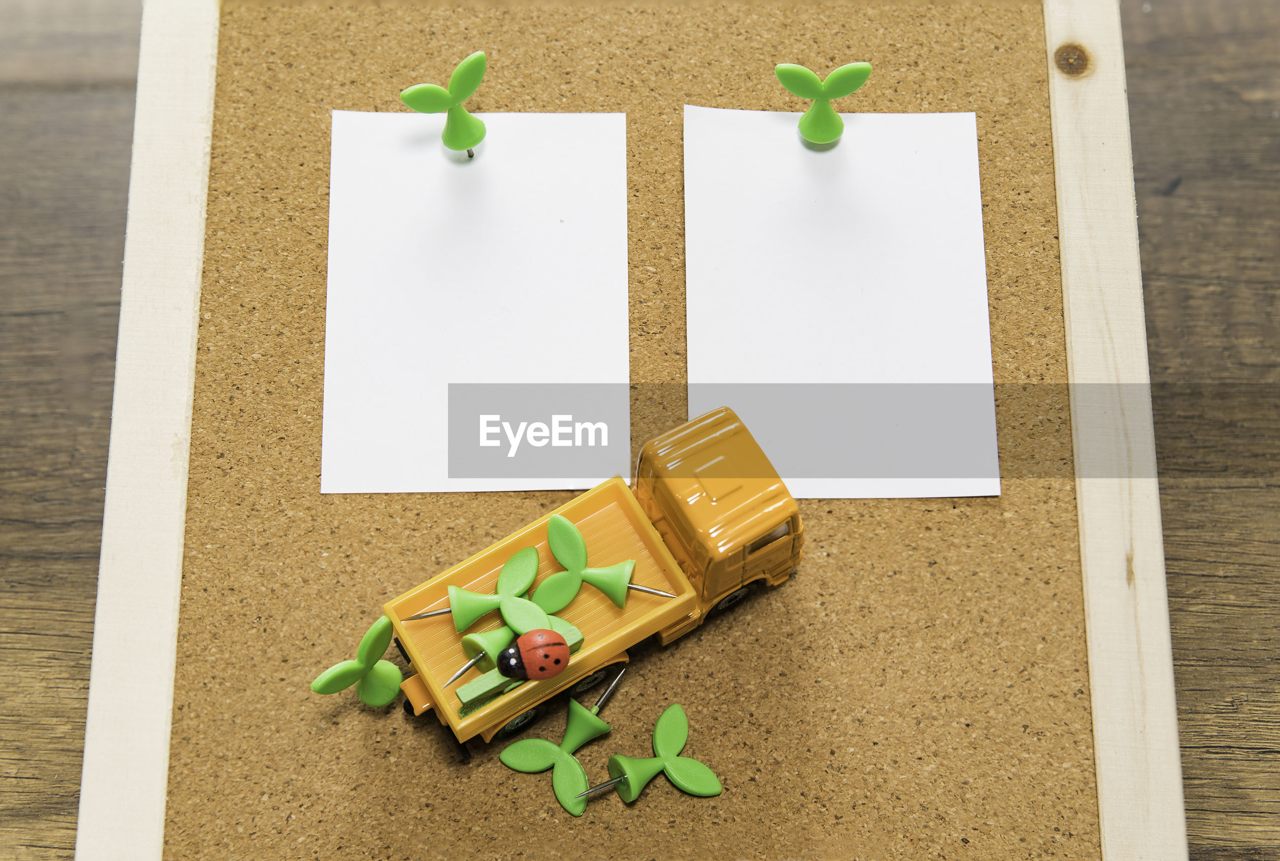 High angle view of toy truck on papers over table