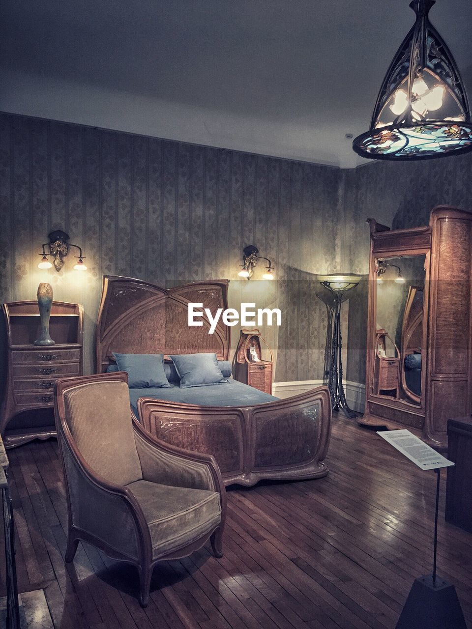 illuminated, electric lamp, lighting equipment, home interior, indoors, home showcase interior, luxury, living room, no people, lamp shade, floor lamp, domestic life, domestic room, night, furniture, side table