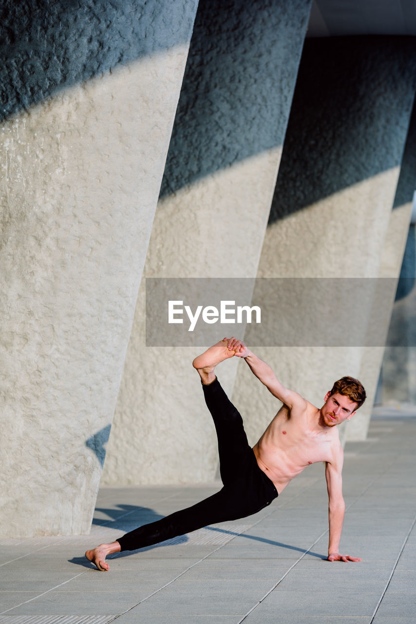 Low section of man skateboarding on wall