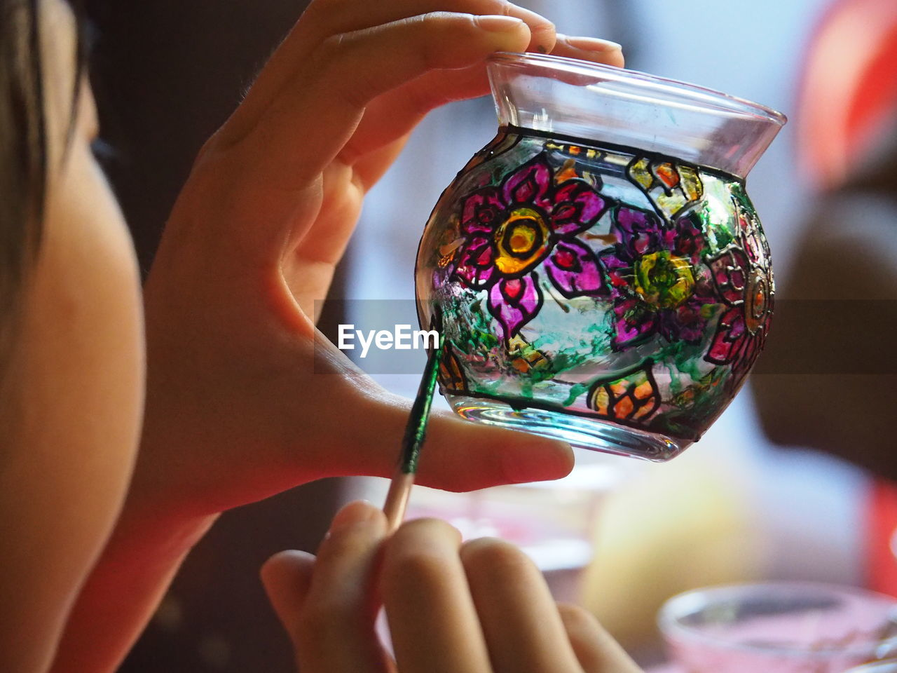 Close-Up Of Girl Painting On Glass Jar