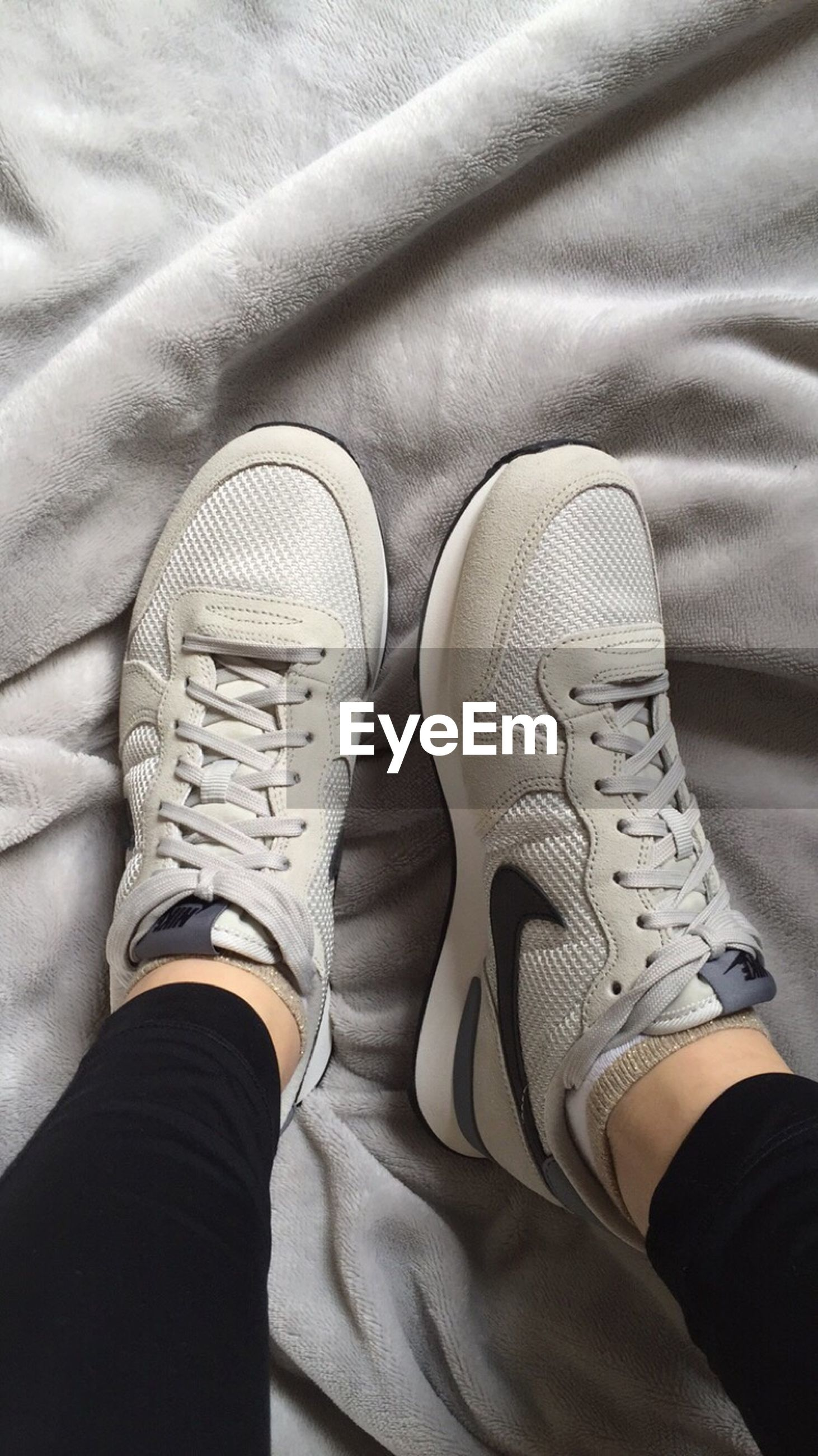 low section, person, shoe, personal perspective, jeans, lifestyles, footwear, men, human foot, standing, leisure activity, canvas shoe, unrecognizable person, part of, high angle view, casual clothing, close-up