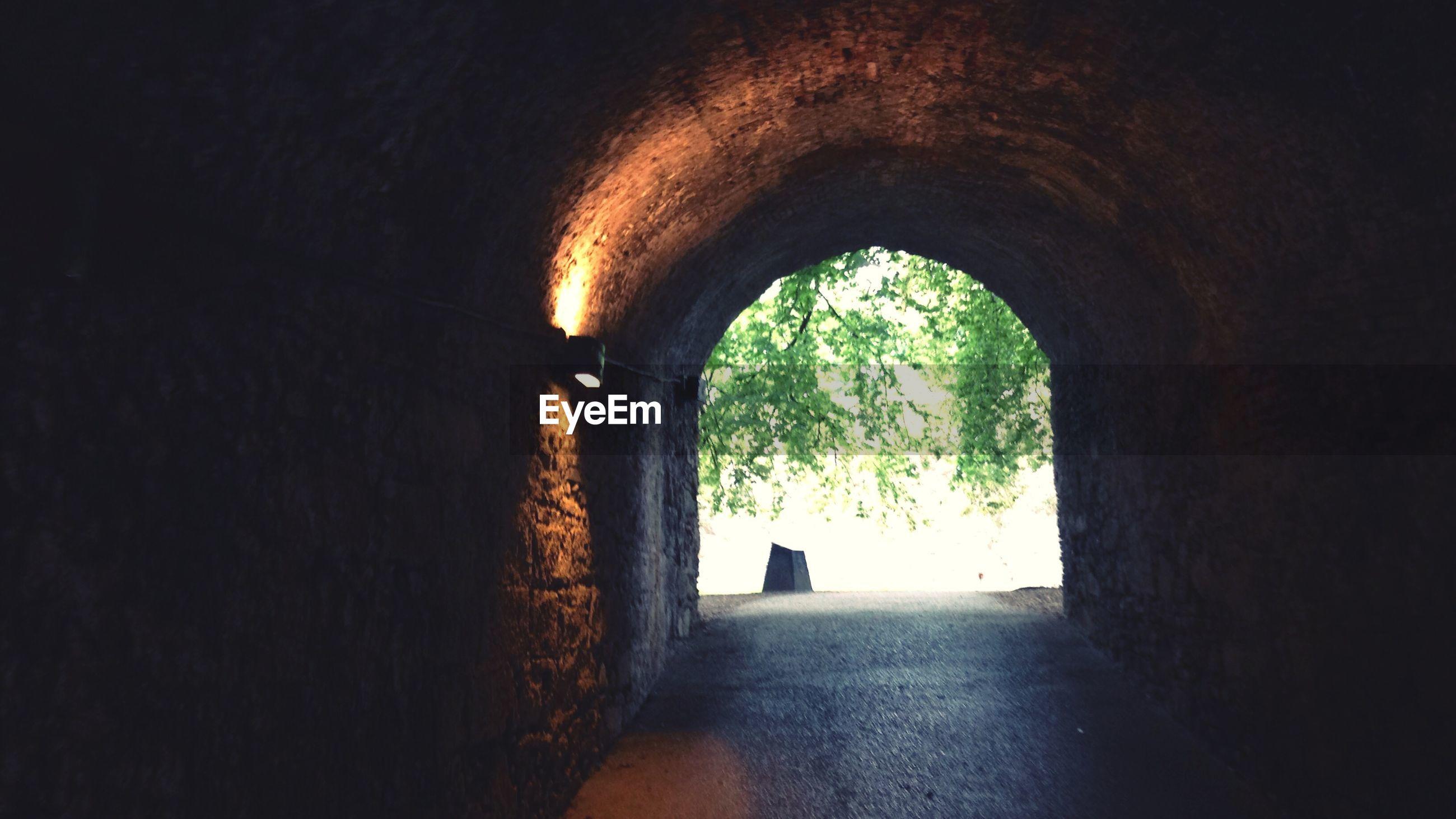 Illuminated light fixture in tunnel