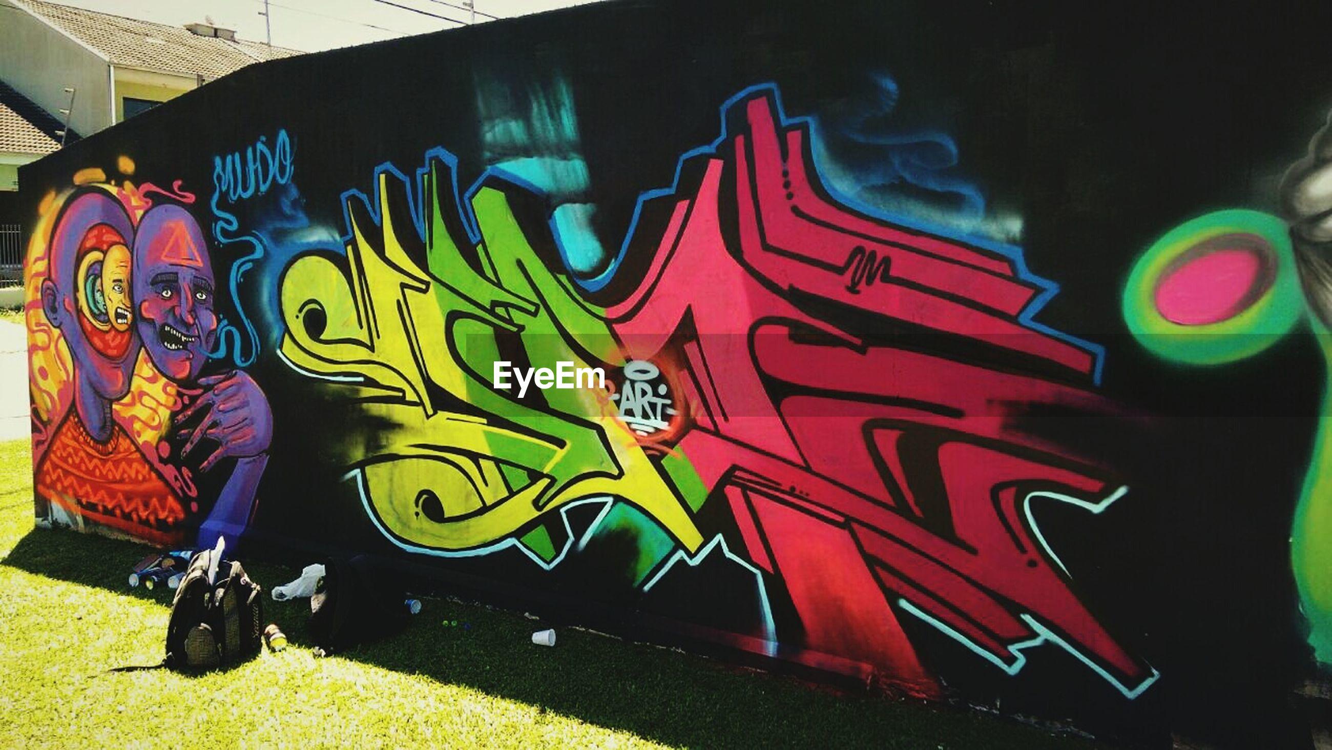 art, graffiti, art and craft, creativity, multi colored, human representation, animal representation, street art, indoors, text, wall - building feature, design, arts culture and entertainment, pattern, leisure activity