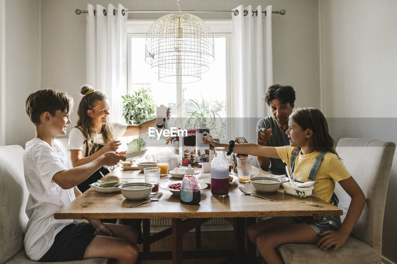 GROUP OF PEOPLE SITTING ON TABLE AT RESTAURANT