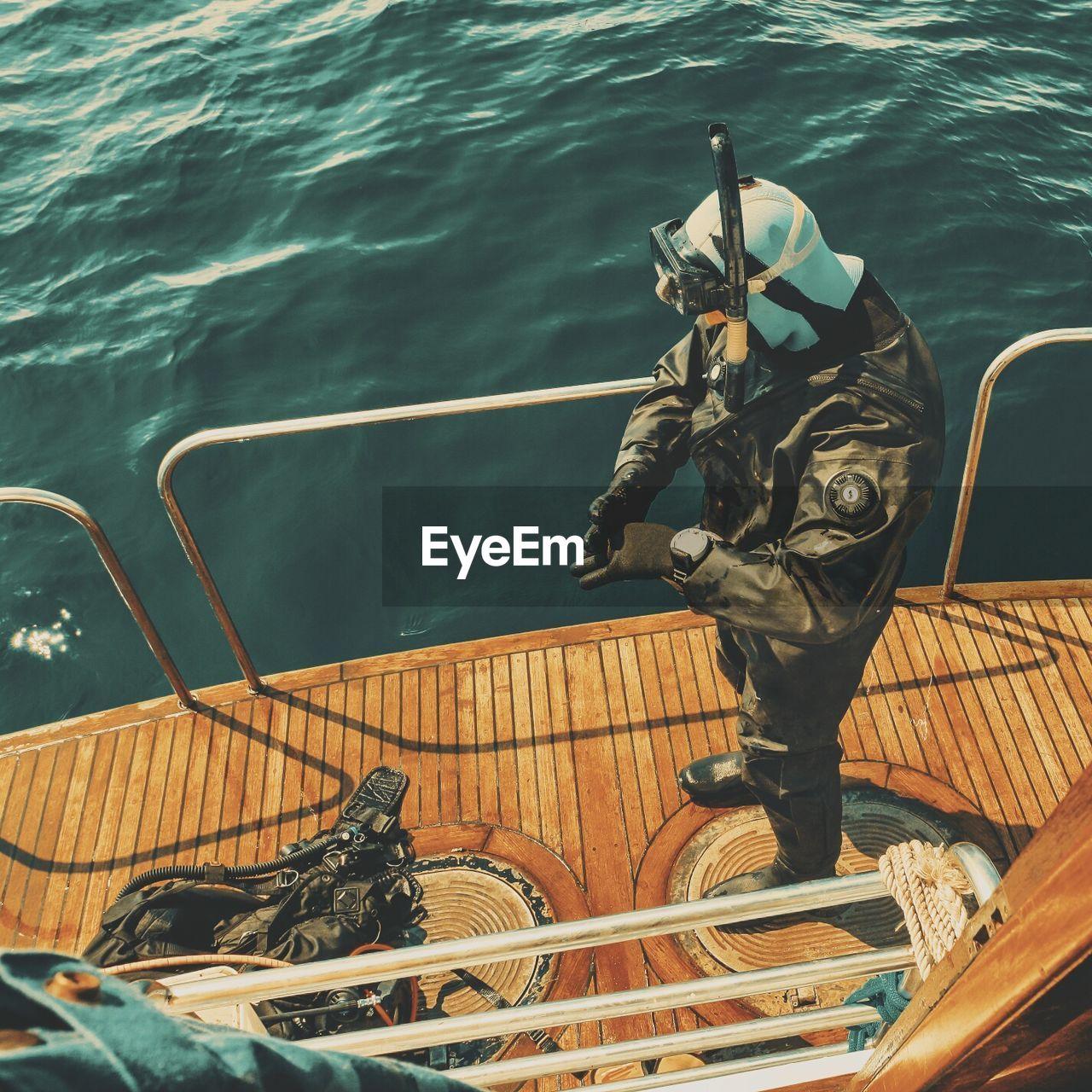 High angle view of man on boat at sea