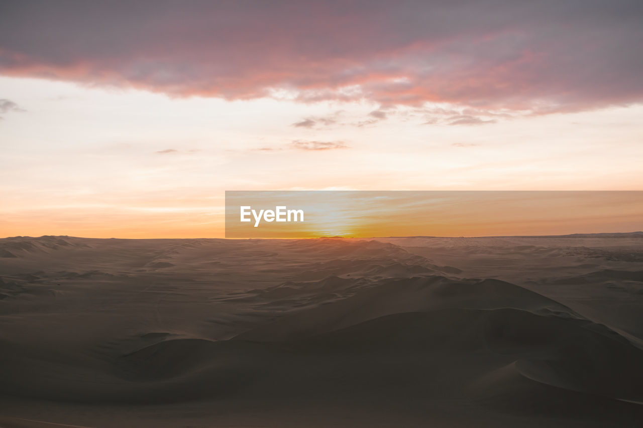 sunset, sky, scenics - nature, beauty in nature, tranquil scene, tranquility, cloud - sky, idyllic, orange color, landscape, non-urban scene, nature, land, no people, environment, remote, sand, sun, sunlight, desert, outdoors, arid climate, climate