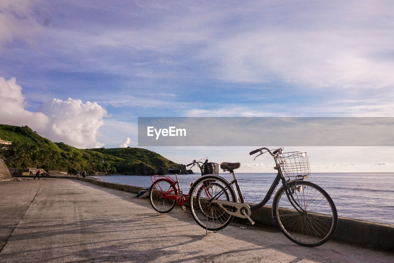cloud - sky, transportation, sky, bicycle, mode of transportation, land vehicle, nature, water, day, sea, outdoors, no people, beauty in nature, scenics - nature, stationary, travel, road, beach, city