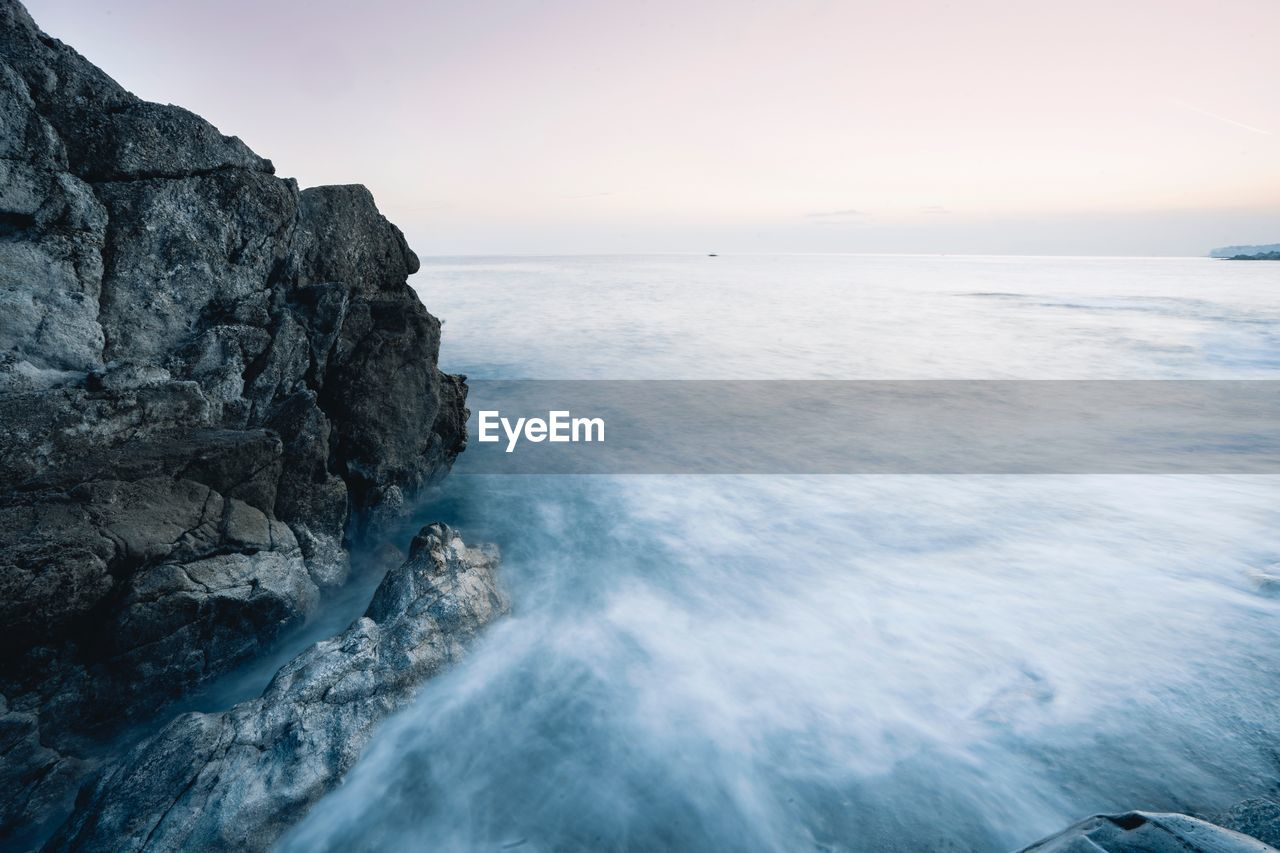 sea, water, beauty in nature, scenics - nature, sky, horizon over water, horizon, rock, tranquil scene, rock - object, tranquility, nature, solid, no people, motion, land, idyllic, non-urban scene, rock formation, outdoors, rocky coastline, power in nature