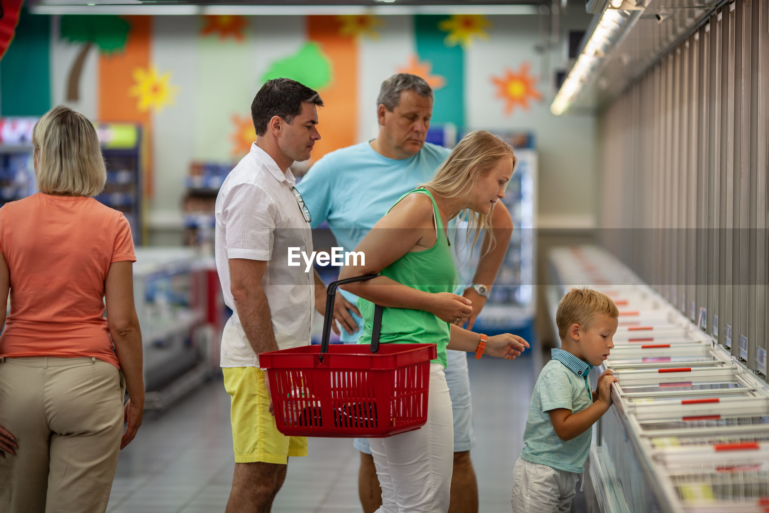 Family standing at supermarket