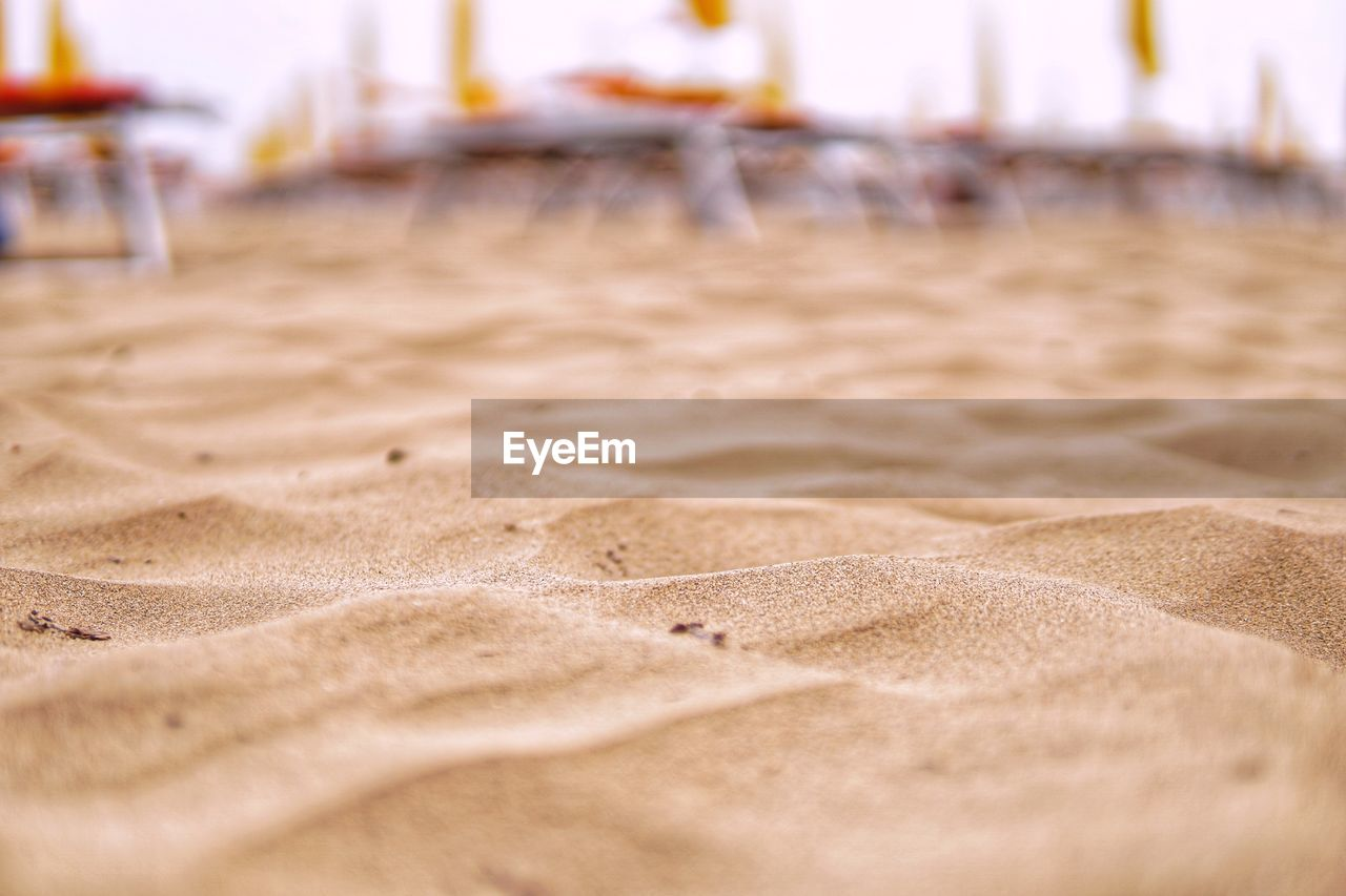 beach, sand, land, no people, selective focus, day, nature, focus on foreground, outdoors, tranquility, close-up, brown, absence, sport, in a row, beauty in nature, surface level, scenics - nature, sky