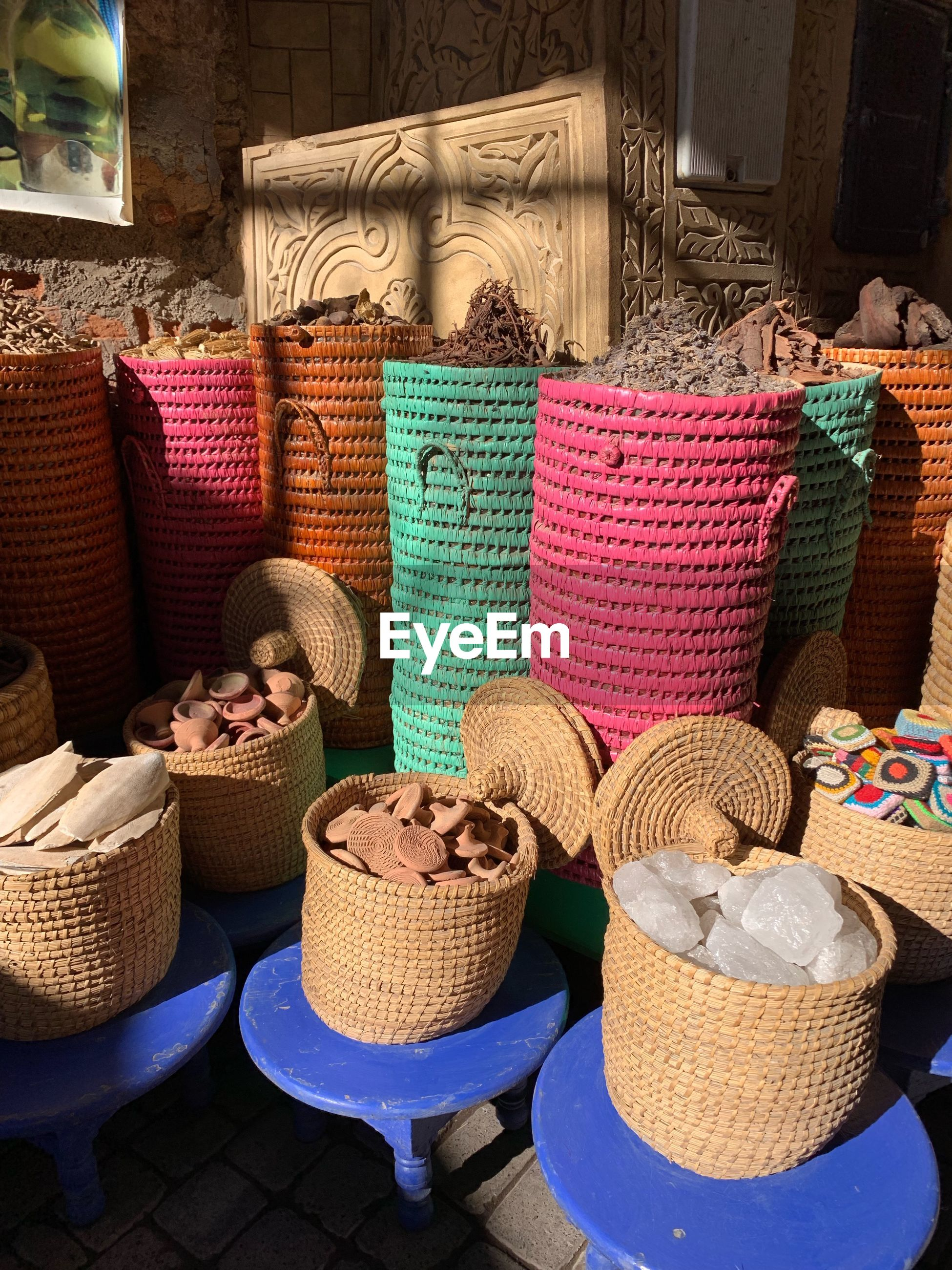 Various objects in baskets for sale at market stall