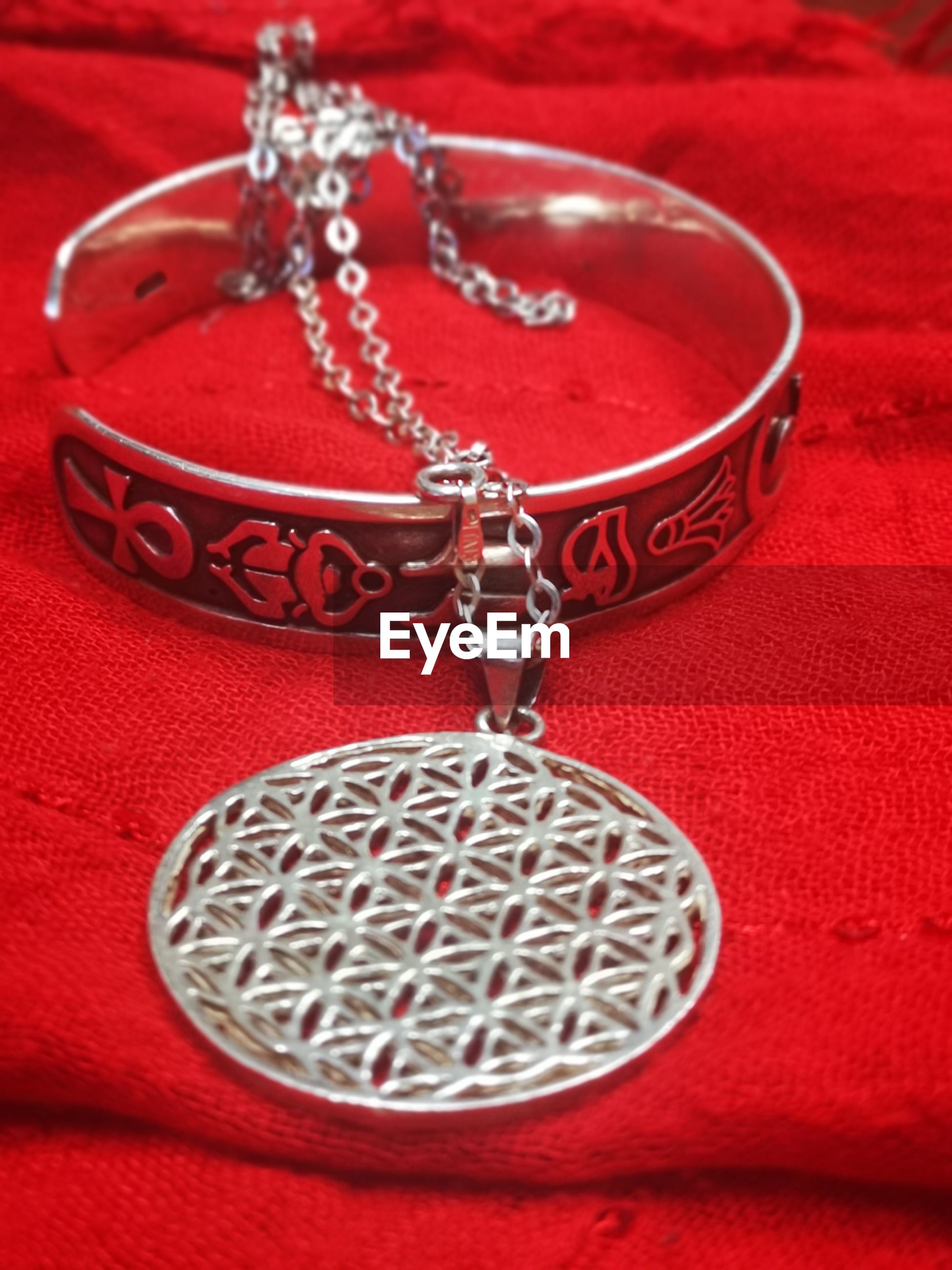 High angle view of bracelet on textile
