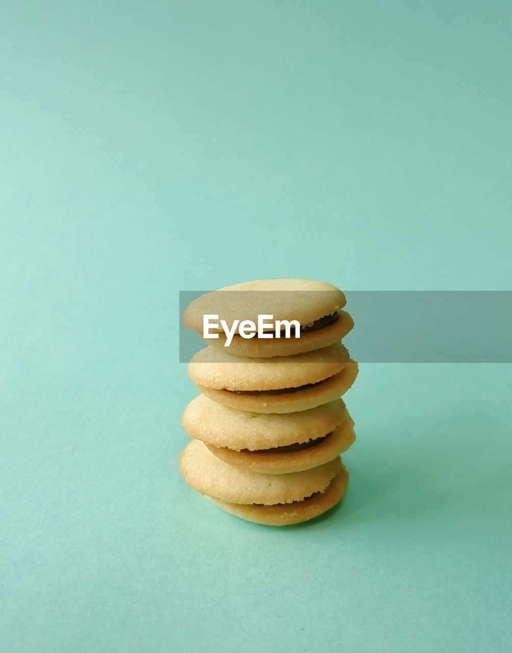 Close-Up Of Stacked Biscuits On Green Table