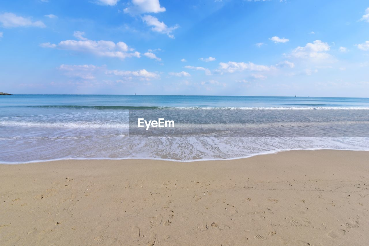 sea, beach, water, land, sky, beauty in nature, scenics - nature, horizon over water, tranquility, horizon, cloud - sky, tranquil scene, sand, motion, idyllic, wave, nature, non-urban scene, no people, outdoors