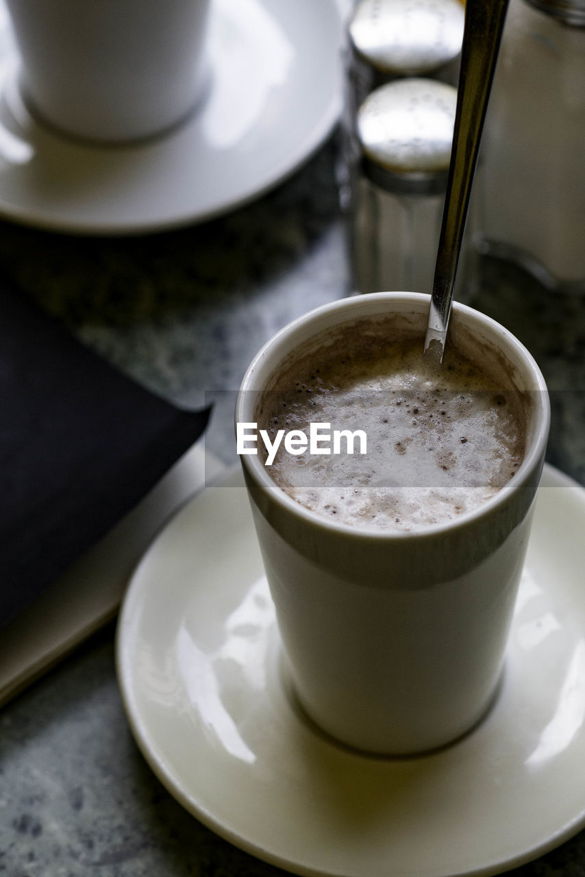 food and drink, drink, refreshment, coffee, coffee - drink, cup, mug, coffee cup, table, indoors, saucer, still life, freshness, crockery, frothy drink, food, close-up, no people, high angle view, hot drink, froth, latte, non-alcoholic beverage, temptation