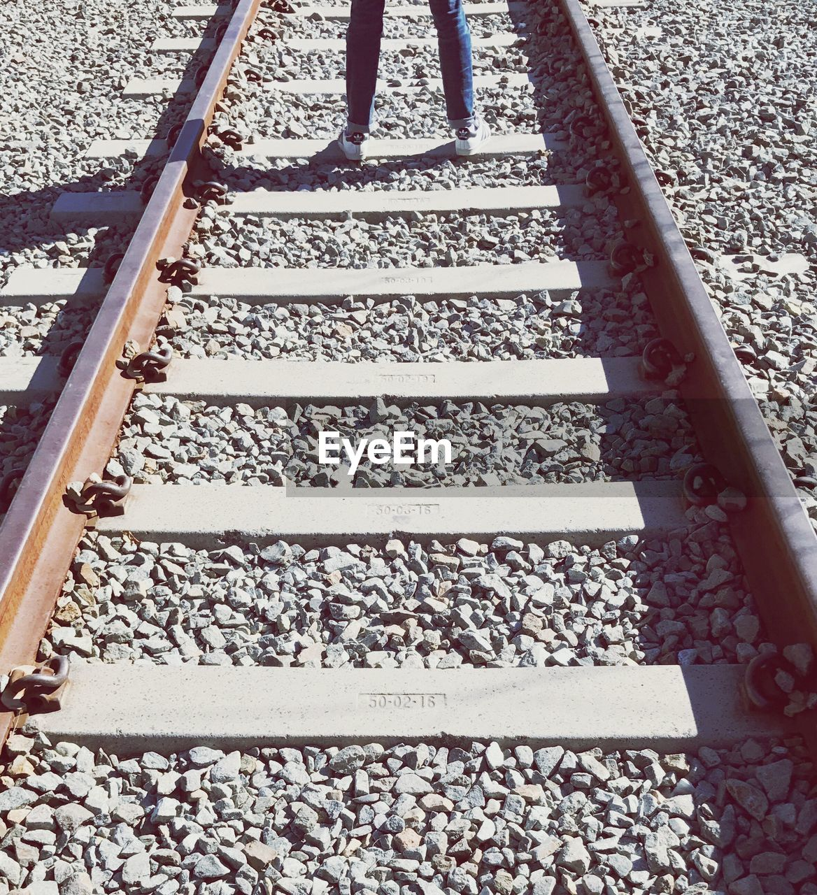 railroad track, rail transportation, low section, railroad tie, day, real people, one person, outdoors, people