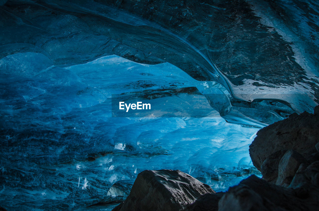 water, cold temperature, nature, frozen, rock, cave, ice, no people, rock - object, winter, solid, beauty in nature, snow, tranquility, sea, environment, day, glacier, flowing water, turquoise colored, eroded