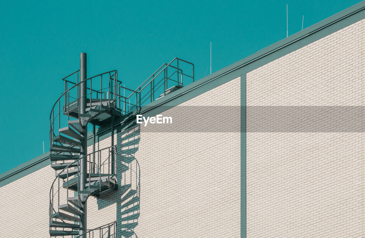 Low Angle View Of Spiral Staircase On Building Against Sky