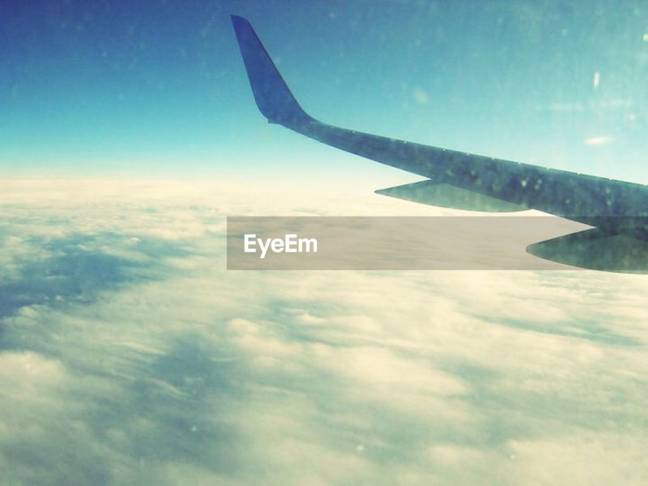 transportation, airplane, sky, aerial view, cloud - sky, journey, nature, no people, flying, air vehicle, outdoors, aircraft wing, day, airplane wing, space