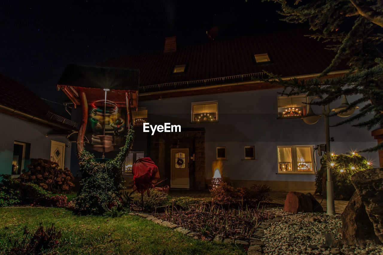 night, built structure, building exterior, architecture, nature, illuminated, plant, building, house, outdoors, tree, no people, residential district, growth, decoration, celebration, front or back yard, lighting equipment