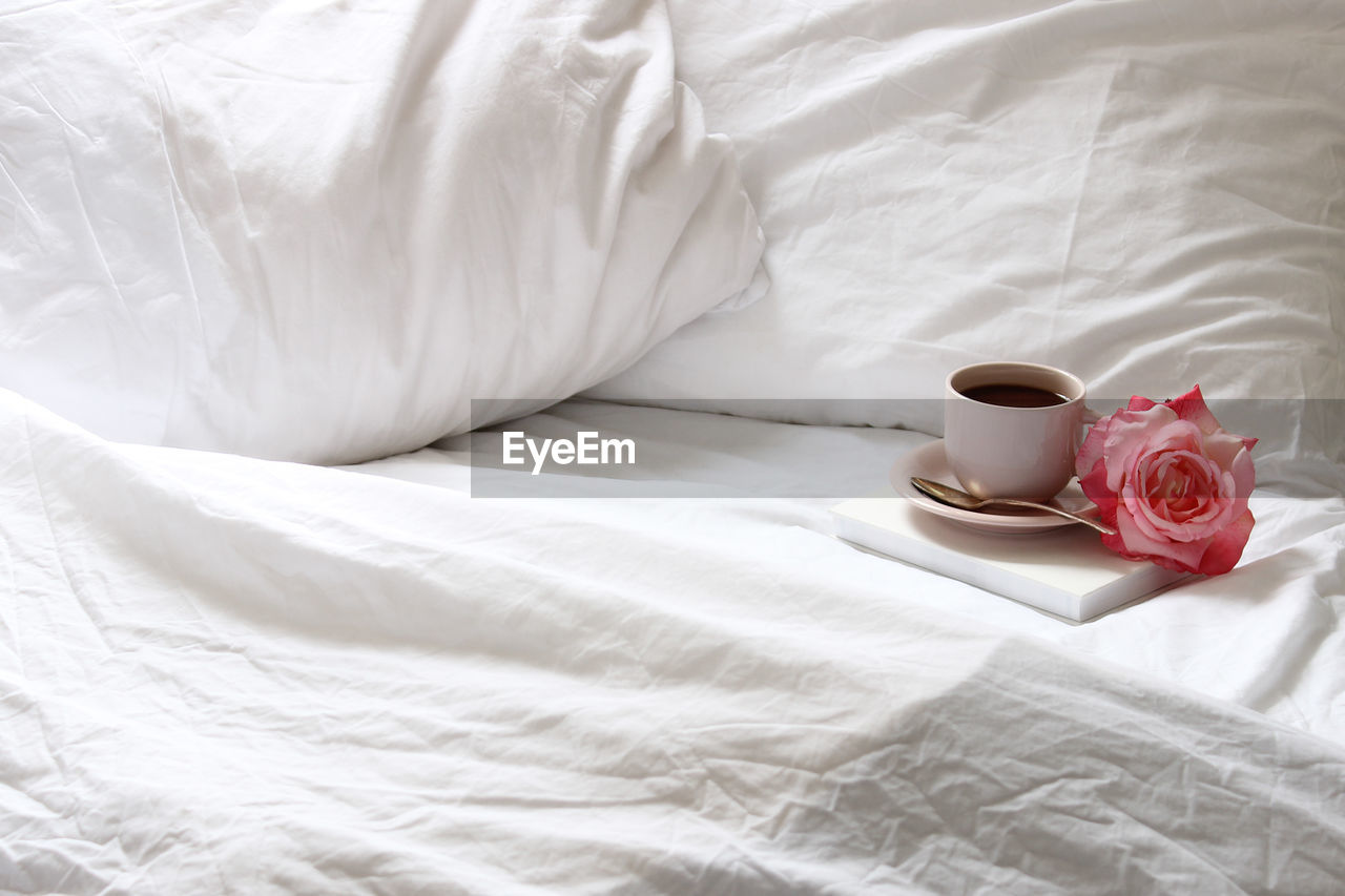 Coffee Cup And Rose On Bed At Home