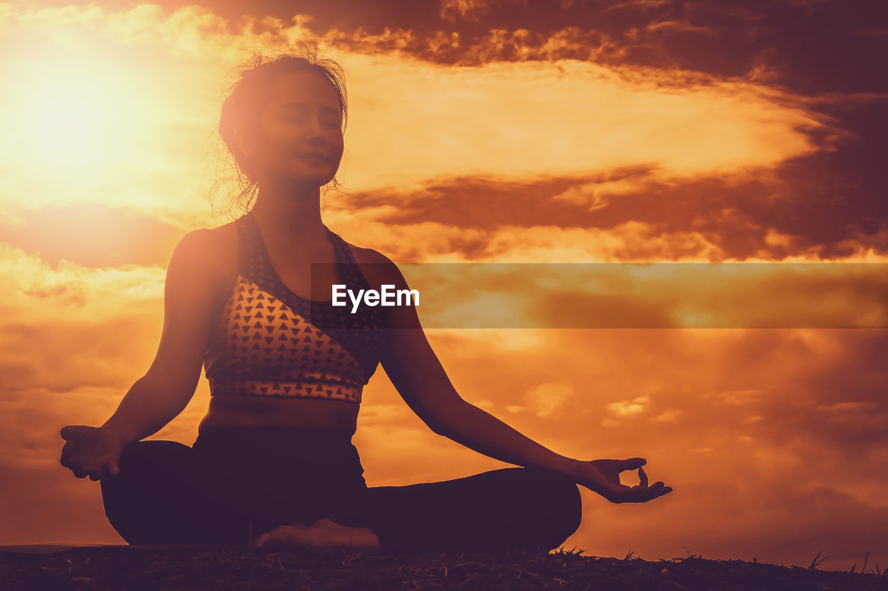 sunset, yoga, cloud - sky, sky, one person, exercising, relaxation exercise, meditating, lifestyles, leisure activity, spirituality, healthy lifestyle, real people, wellbeing, sport, zen-like, nature, cross-legged, sitting, women, posture, outdoors, beautiful woman, human arm