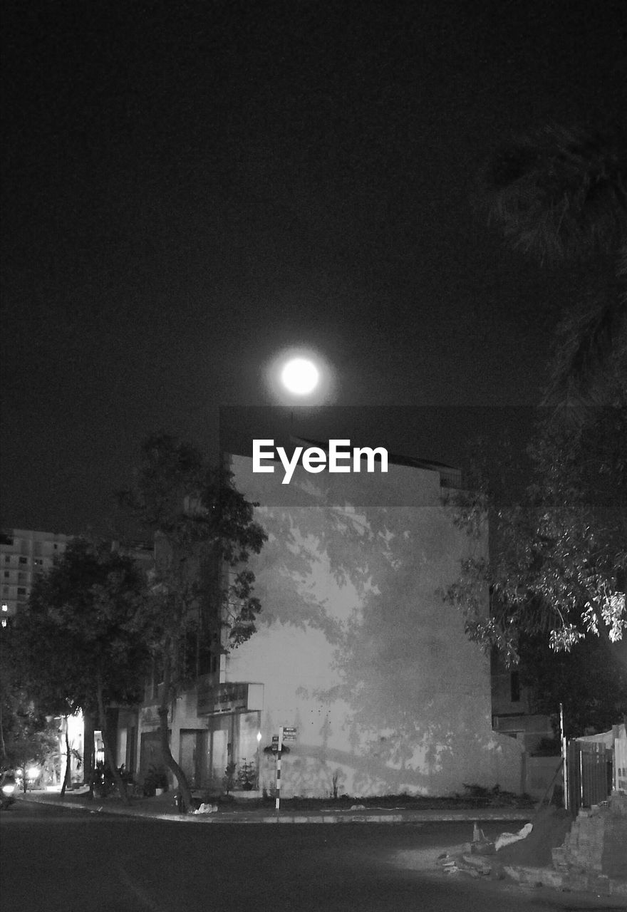 illuminated, tree, night, street light, outdoors, sky, no people, nature, city