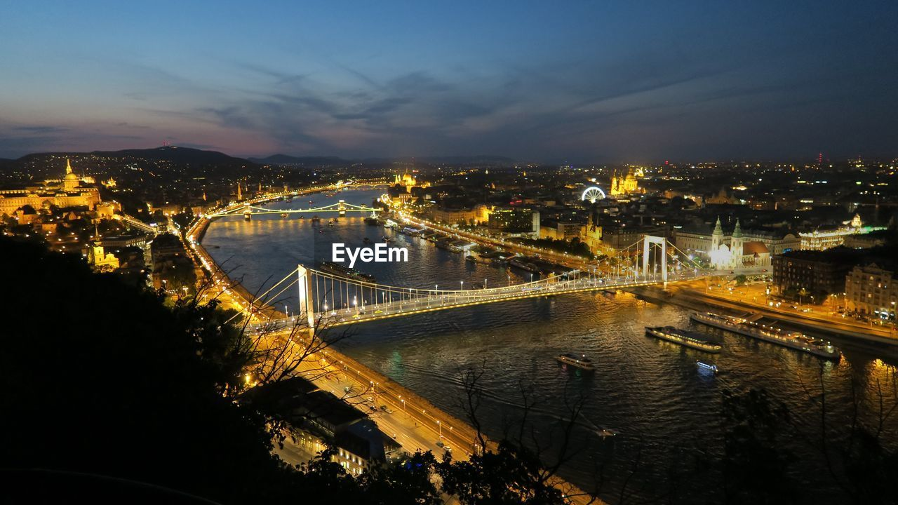 architecture, built structure, bridge, connection, water, bridge - man made structure, transportation, illuminated, building exterior, city, river, sky, nature, chain bridge, night, cityscape, no people, high angle view, outdoors