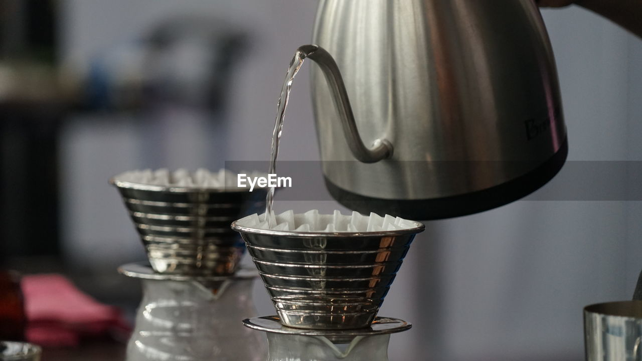 metal, food and drink, indoors, focus on foreground, close-up, no people, kitchen, kitchen utensil, household equipment, domestic room, container, still life, appliance, home, food, domestic kitchen, cup, preparation, silver colored, drink, steel