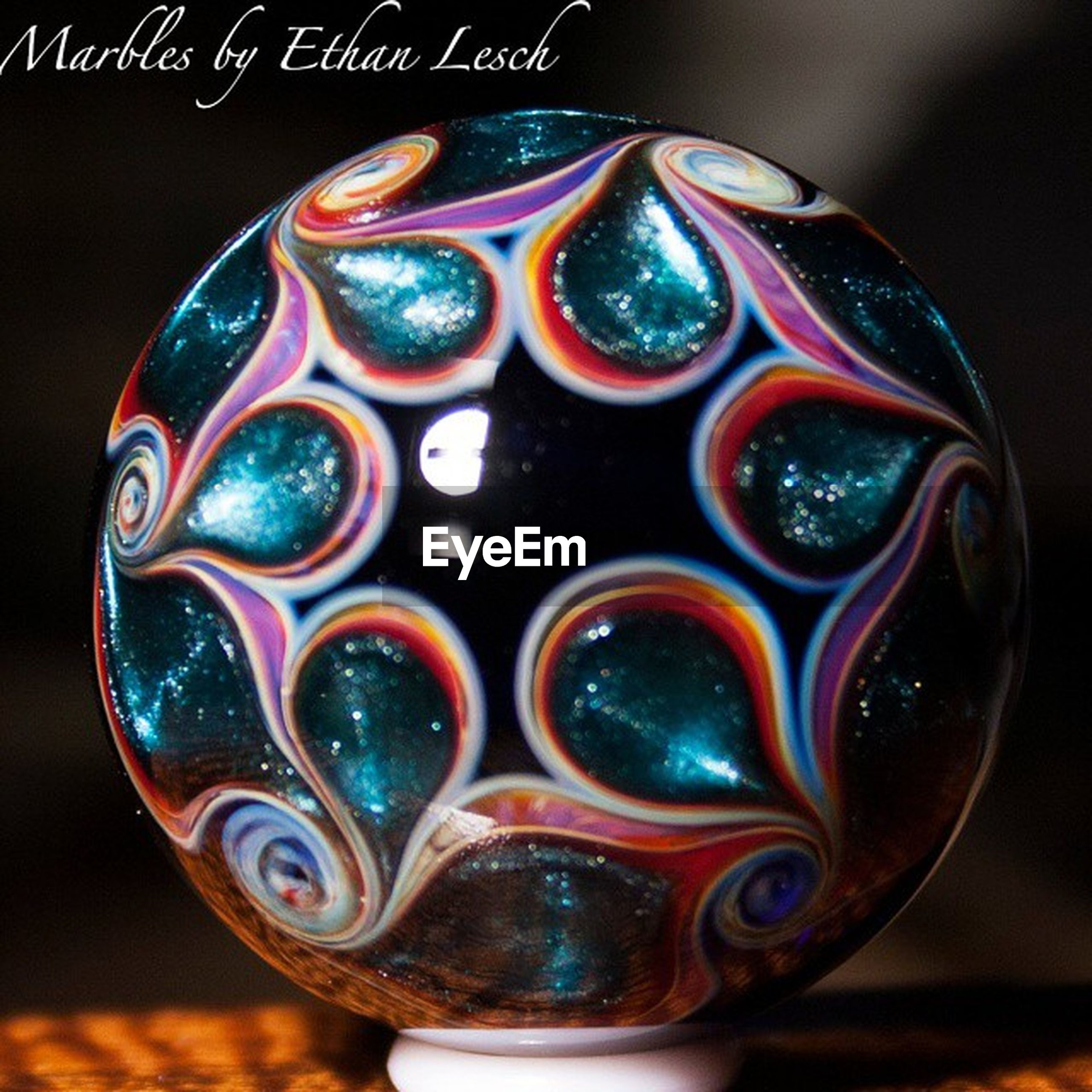close-up, focus on foreground, sphere, pattern, art and craft, circle, still life, indoors, design, single object, creativity, shiny, art, studio shot, no people, shape, selective focus, blue, round, geometric shape