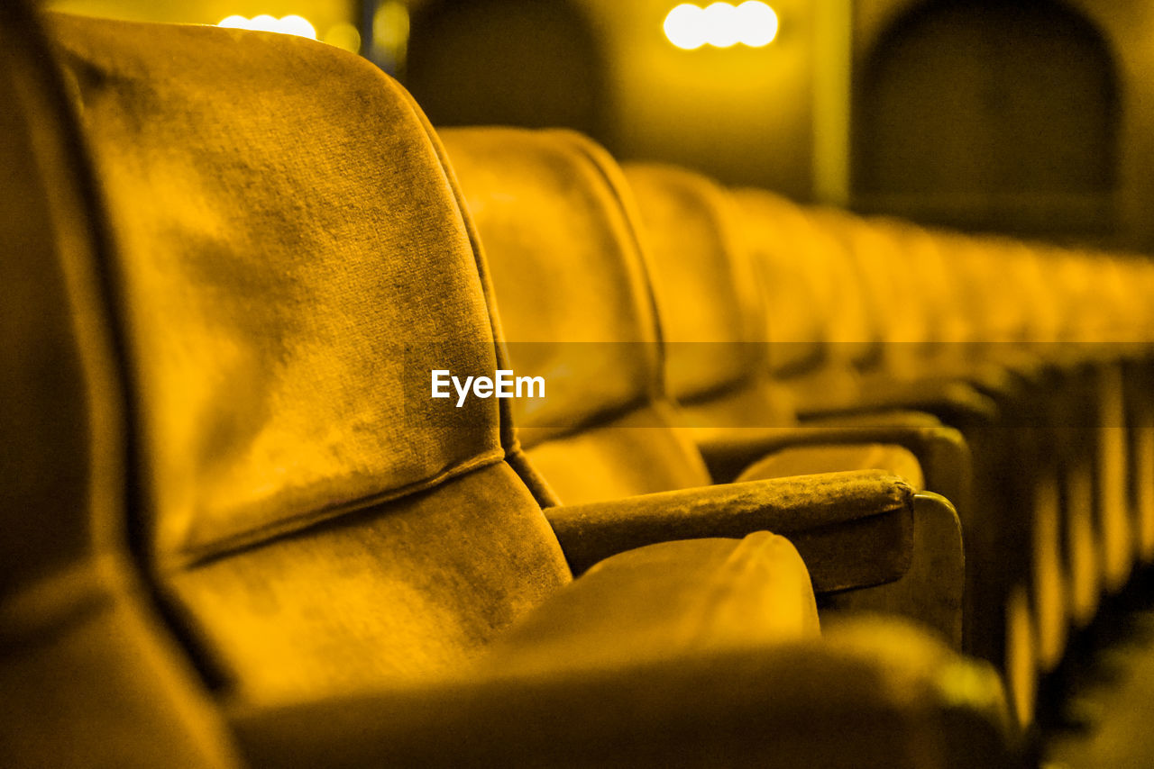 Close-Up Of Yellow Seats In Row