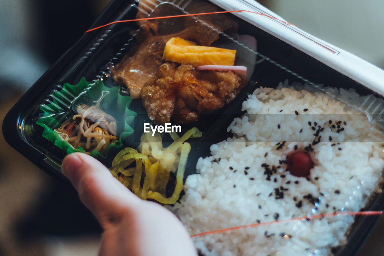 food and drink, food, hand, human hand, human body part, freshness, real people, holding, ready-to-eat, one person, indoors, unrecognizable person, meat, close-up, lifestyles, bowl, chopsticks, wellbeing, healthy eating, body part, meal, finger, japanese food, temptation