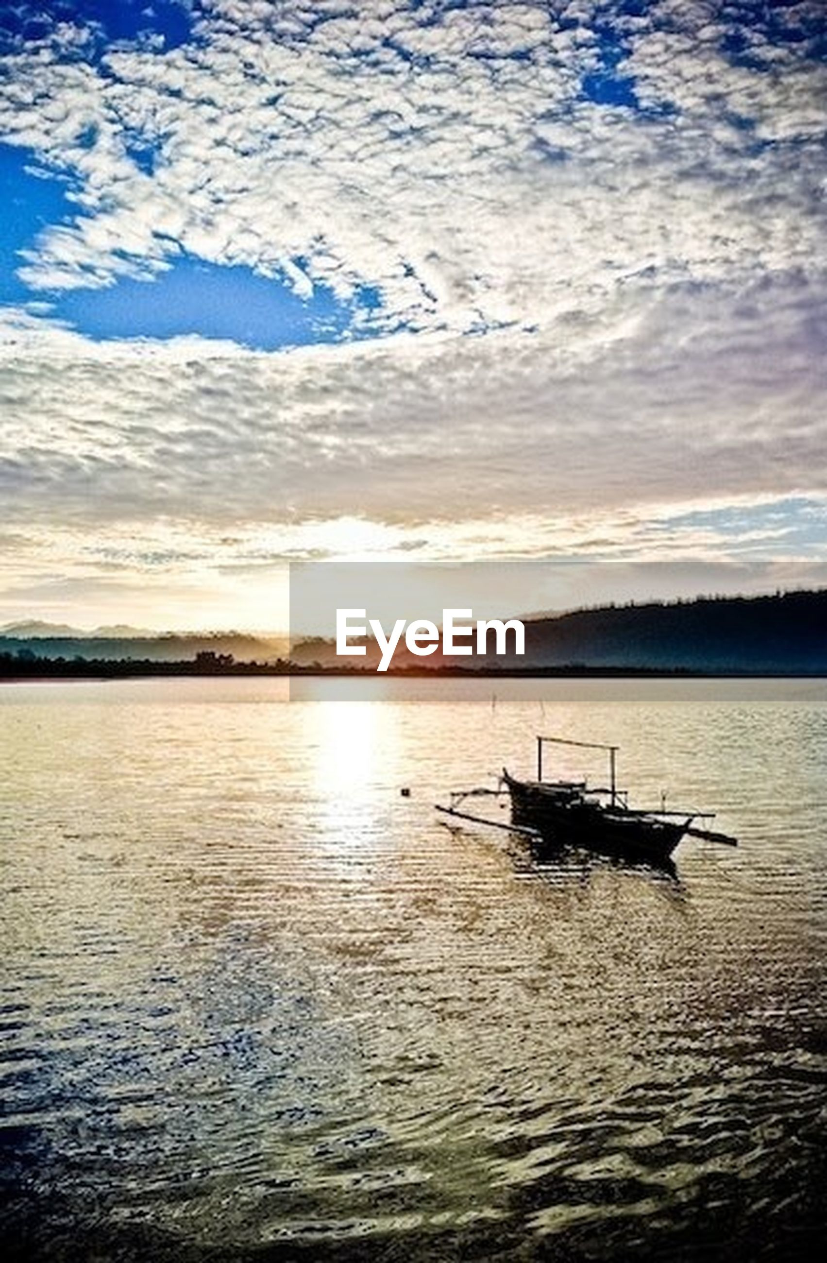 water, nautical vessel, boat, transportation, tranquil scene, tranquility, mode of transport, scenics, waterfront, beauty in nature, lake, sunset, nature, reflection, sky, rippled, silhouette, moored, idyllic, travel