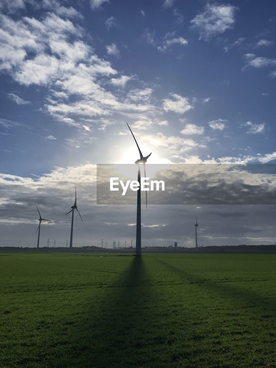 environment, fuel and power generation, wind turbine, sky, turbine, renewable energy, alternative energy, wind power, field, land, environmental conservation, grass, landscape, cloud - sky, scenics - nature, beauty in nature, nature, green color, technology, no people, outdoors, sustainable resources, power supply
