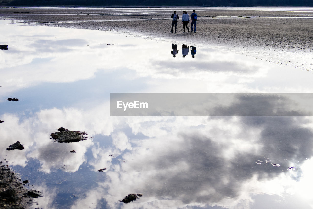 cloud - sky, sky, beach, real people, nature, water, land, beauty in nature, lifestyles, day, men, unrecognizable person, leisure activity, people, tranquility, scenics - nature, group of people, outdoors