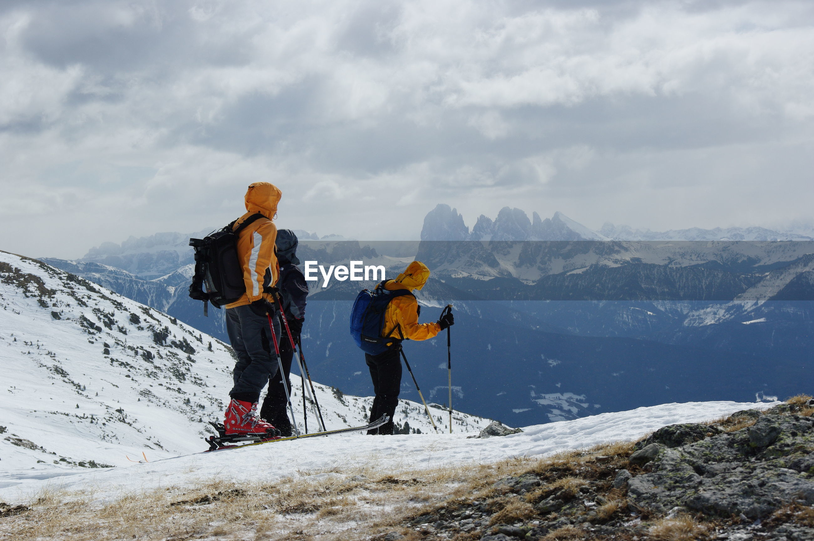 People standing on snowcapped mountain