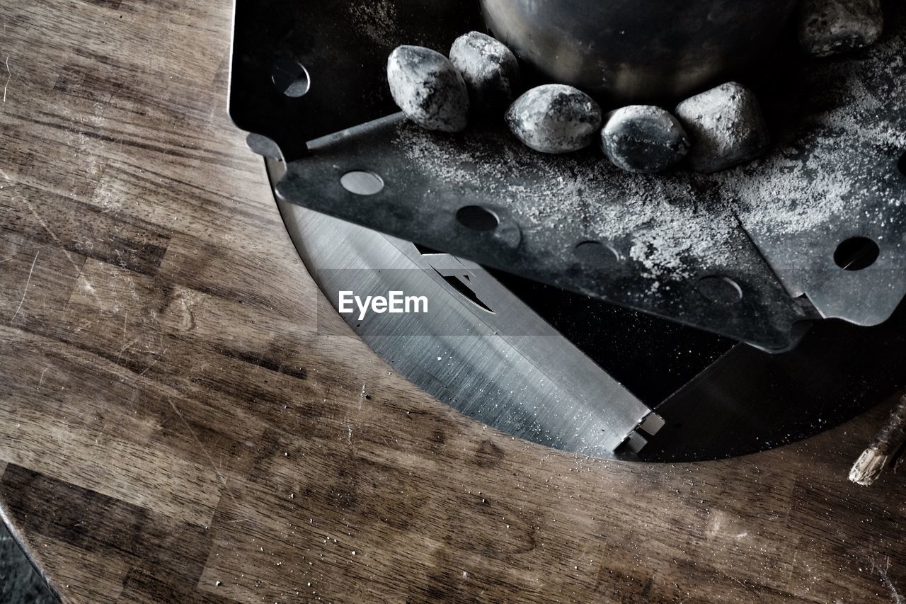 indoors, table, wood - material, high angle view, still life, food, no people, food and drink, freshness, close-up, preparation, cutting board, kitchen knife, sharp, kitchen utensil, flour, directly above, healthy eating, wellbeing, metal