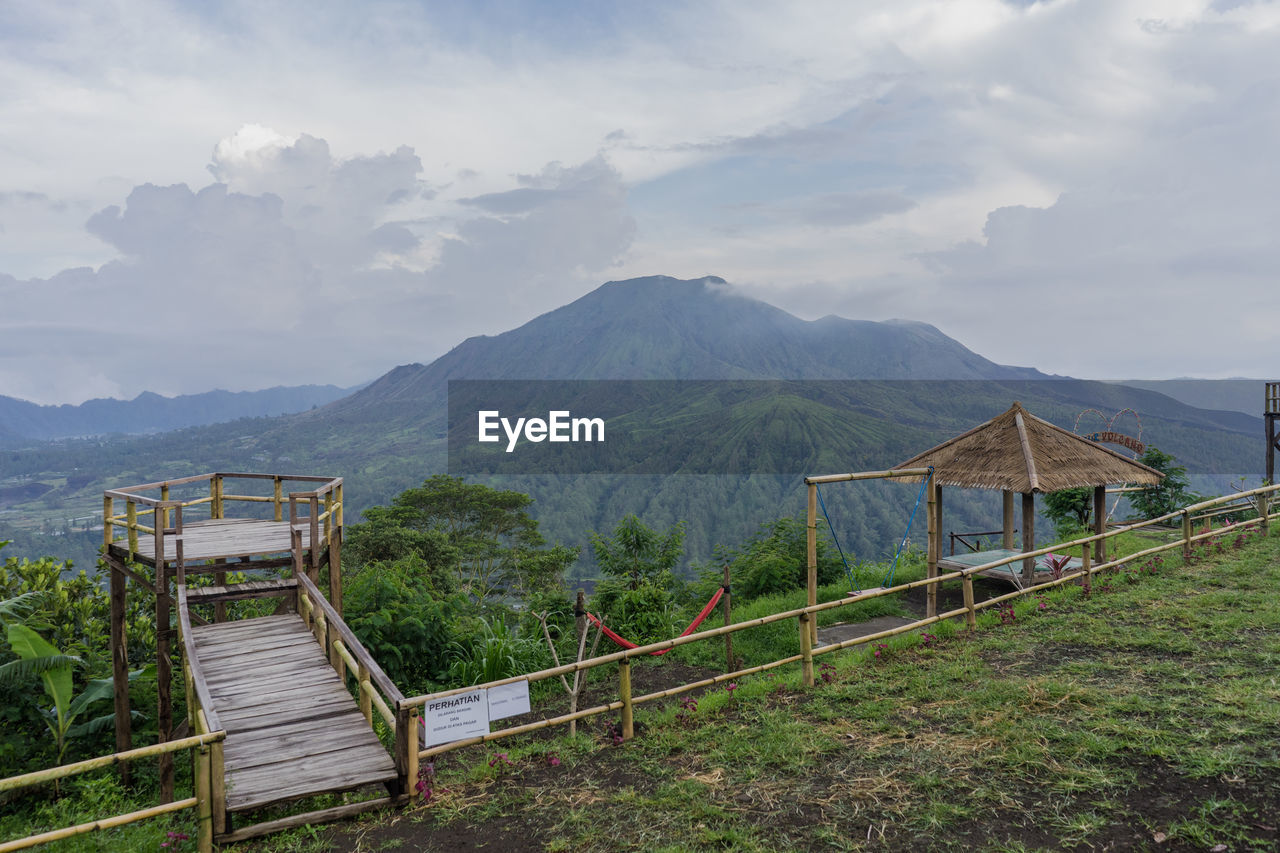 mountain, scenics - nature, cloud - sky, beauty in nature, sky, mountain range, railing, tranquil scene, nature, non-urban scene, architecture, tranquility, environment, landscape, day, idyllic, built structure, no people, land, outdoors