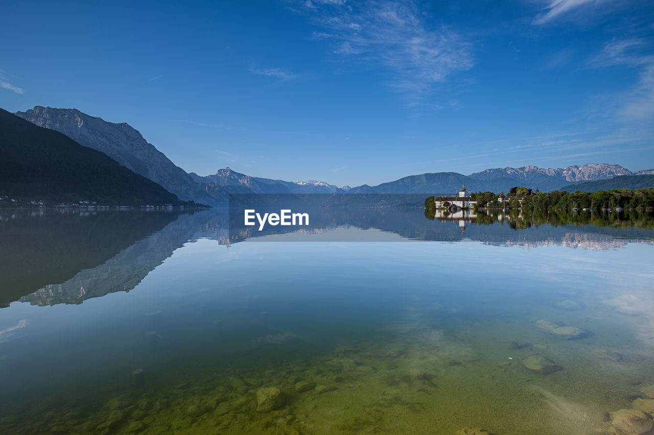 water, mountain, scenics - nature, beauty in nature, sky, reflection, tranquil scene, tranquility, lake, nature, idyllic, cloud - sky, waterfront, blue, no people, non-urban scene, mountain range, day, standing water