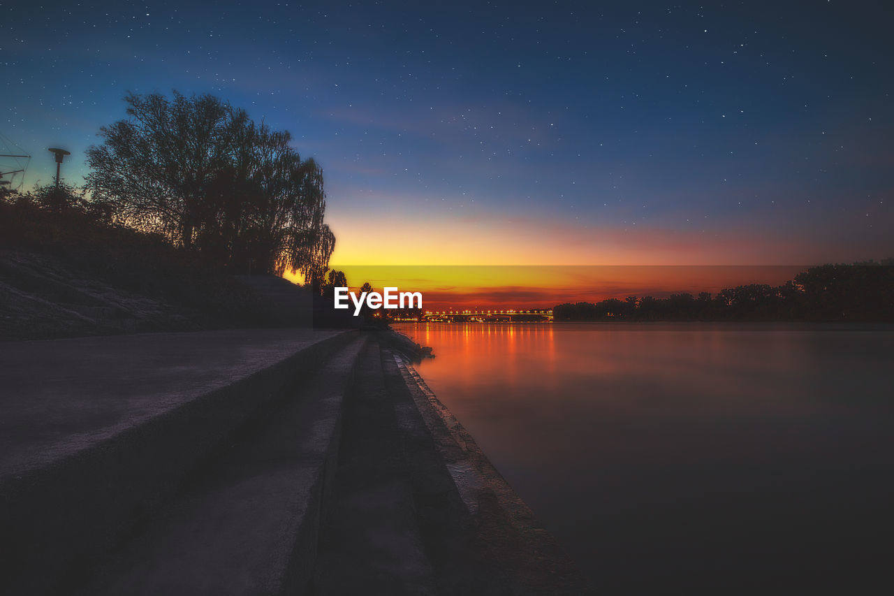 sky, water, tree, scenics - nature, nature, beauty in nature, plant, no people, sunset, tranquility, tranquil scene, lake, reflection, star - space, outdoors, night, orange color, direction, the way forward
