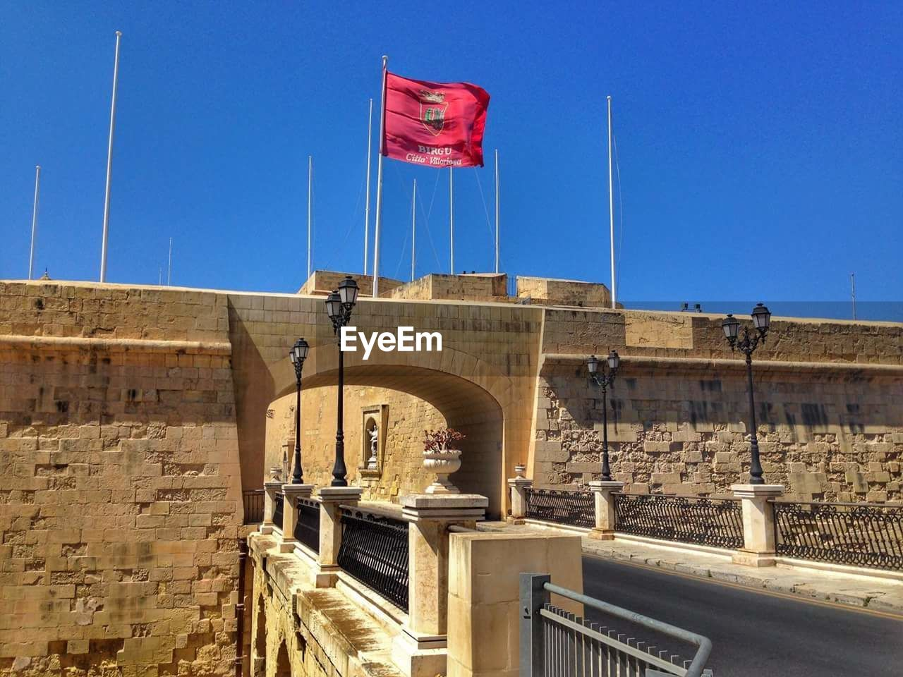 flag, patriotism, day, clear sky, low angle view, no people, red, pride, blue, built structure, outdoors, architecture, sky