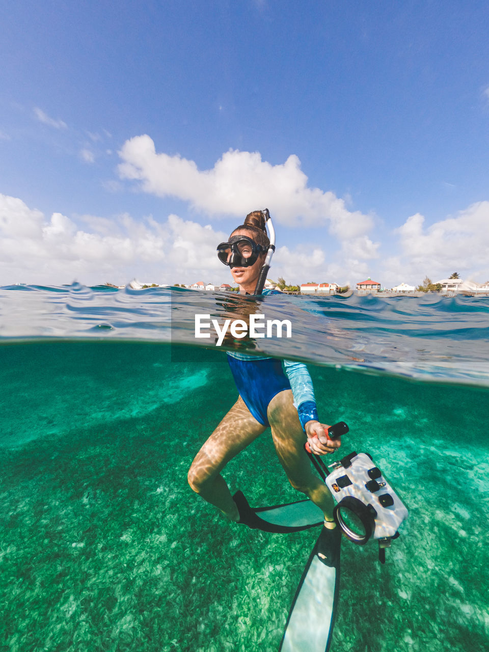 sea, water, leisure activity, one person, lifestyles, sky, sport, nature, aquatic sport, underwater, adventure, real people, beauty in nature, young adult, scuba mask, day, mid adult, full length, snorkeling, outdoors, undersea, eyewear