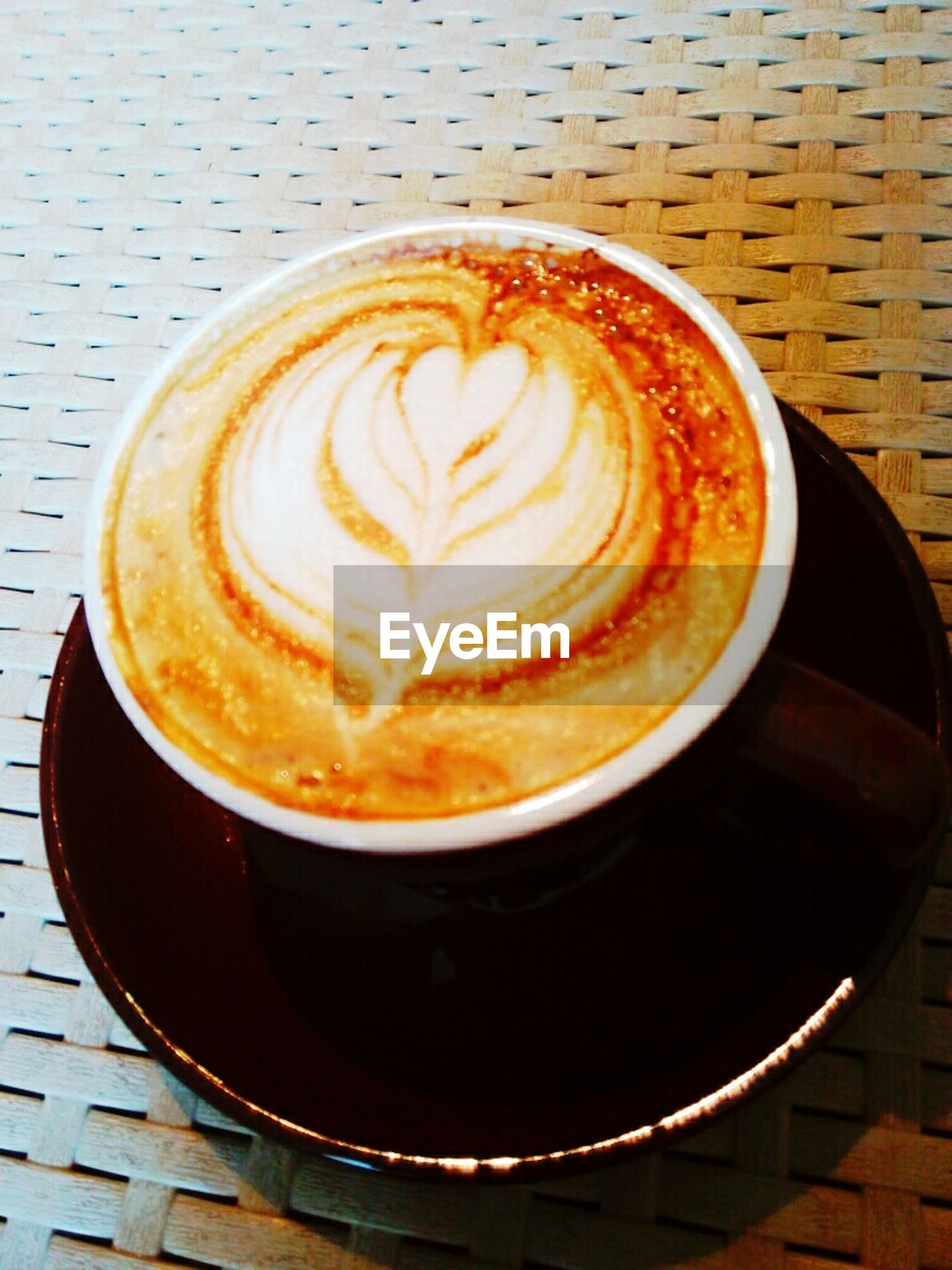coffee cup, coffee - drink, froth art, food and drink, drink, saucer, frothy drink, cappuccino, refreshment, indoors, table, freshness, still life, coffee, close-up, art, high angle view, creativity, directly above, design