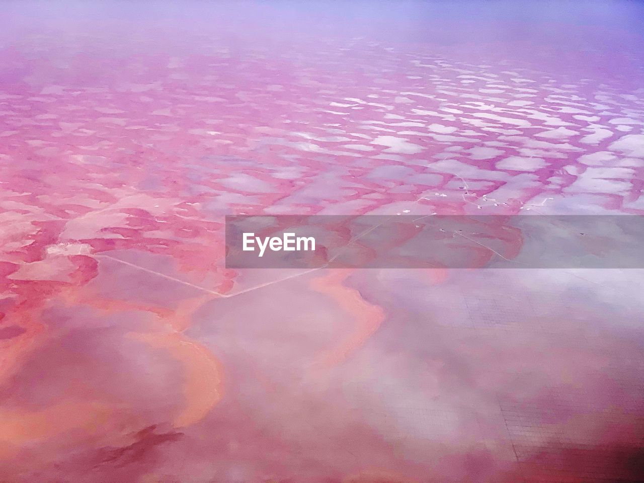 pink color, water, nature, no people, beauty in nature, day, tranquility, full frame, backgrounds, close-up, outdoors, sea, waterfront, reflection, pattern, scenics - nature, frozen, high angle view, softness, marine